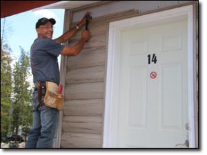 Matthew-installing-the-siding