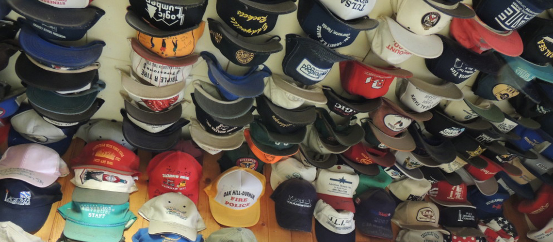 Our world famous hat collection right above while you eat delicious comfort food.